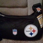 Alison Piatt keeps an extra pin on her Steelers bag.